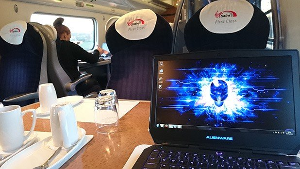 alienware 13 laptop on the train